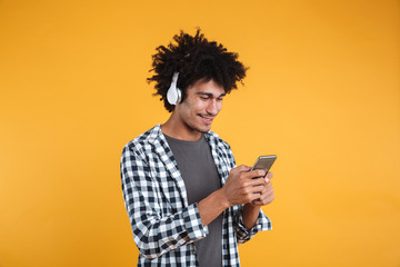 Portrait of happy young african man listening to music