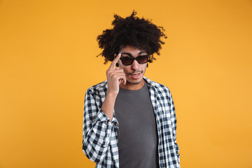 Portrait of a young afro american man posing in sunglasses