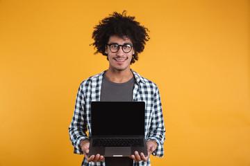 Portrait of a happy smart african man in eyeglasses