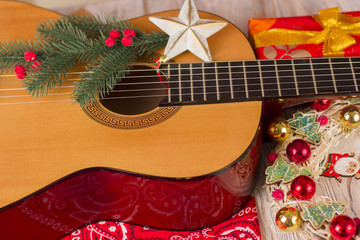 Country music christmas background with guitar and cowboy bandanna