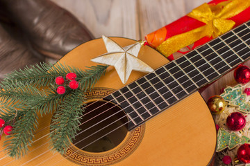 Country music christmas background with guitar and cowboy boots