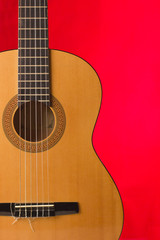 Acoustic guitar on red background