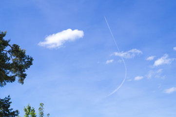 plane with a bent contrail
