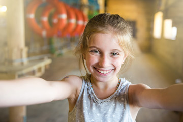 joyful laughing little girl making selfie