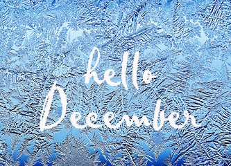 Hello December.Frosty natural pattern on winter window.Frost patterns on glass.Winter ice embroidered lace on the window.