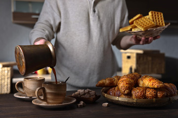 Breakfast with black coffee and fresh pastries