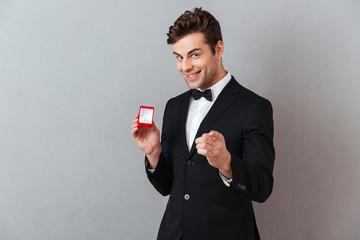 Portrait of a satisfied happy man dressed in tuxedo