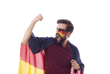 Ecstatic fan with flag of Germany cheering