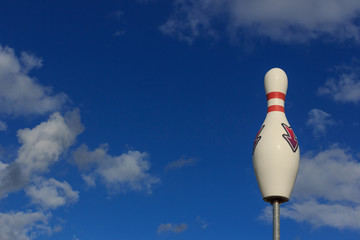 Big pin bowling on the background of blue sky.