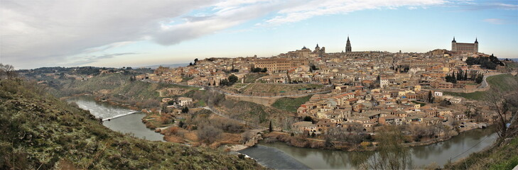 Panoramic photograph of the city of Toledo, Castilla La Mancha, Spain, with the Tagus River and its water mills surrounding the city. View of the streets