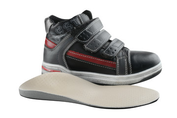 Children's shoe and orthopedic insole