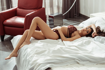 woman in sexy burgundy lingerie