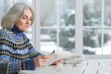 senior woman with newspaper