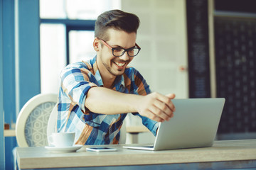 Man enjoying coffee and working