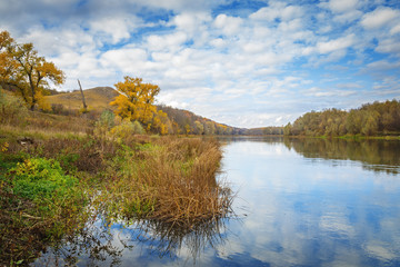 Autumn landscape in central Russia. View of the Dons River by the reflection of the cloudy sky.