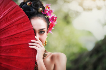 Asian woman with red umbrella,Thai costume