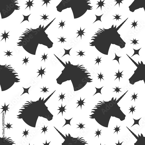 Black unicorn silhouette with stars seamless pattern