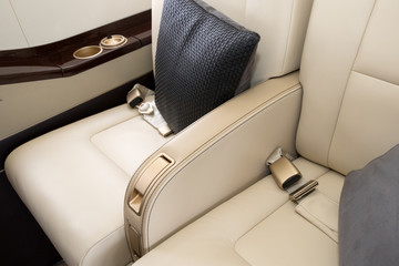 Luxury leather chairs in a VIP business jet plane