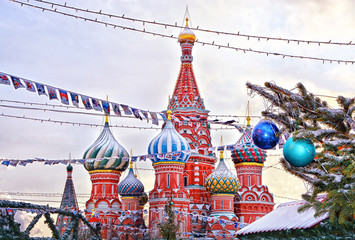 View of Cathedral of St. Basil at the Red Square decorated for New Year and Christmas holidays in winter, Moscow, Russia.