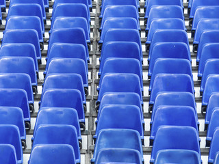 tribune with blue chairs