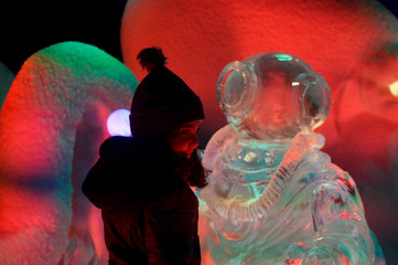 Gabriella Nijjer, age 6, poses with ice sculptures at the launch of Hyde Park Winter Wonderland's Magical Ice Kingdom in London