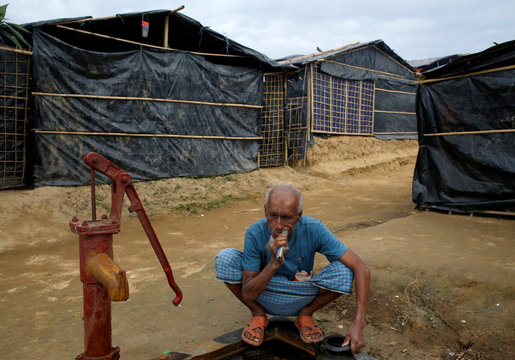 A Rohingya refugee man brushes his teeth as he gets ready for the evening prayer at Palong Khali refugee camp near Cox's Bazar