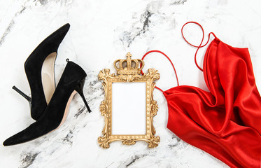 Fashion flat lay Red dress black high heels golden frame