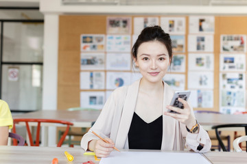Portrait of young woman using phone