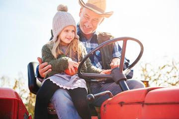 Farmer and granddaughter at pumpkin farm