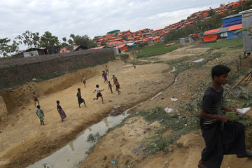 Rohingya refugee children play football in the Palong Khali refugee camp in Cox's Bazar