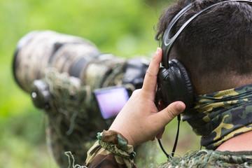 ornithologist using technology of radio to soundcheck of wildlife