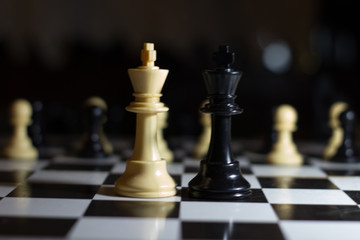 two kings chess board facing each other against a revolution from the pawns