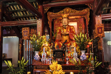 altar of a pagoda inside the temple of the literature, ancient university, in Hanoi, Vietnam.