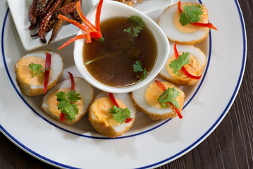 Sweet and sour eggs in white dish Thai food