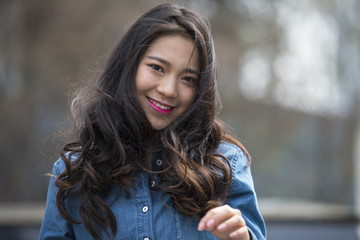One beautiful young asian woman in the street