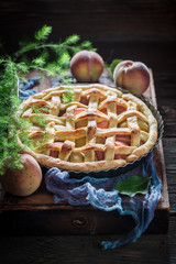 Homemade and delicious peaches pie on blue cloth