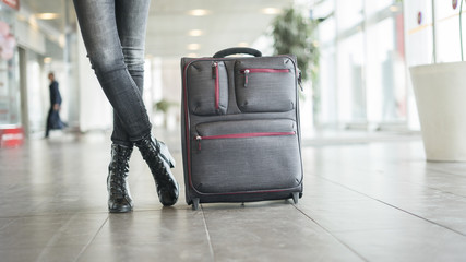 Passenger waiting  at the airport with suitcase
