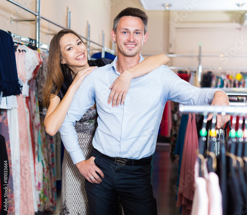 f1be560adb Family couple in female clothes shop