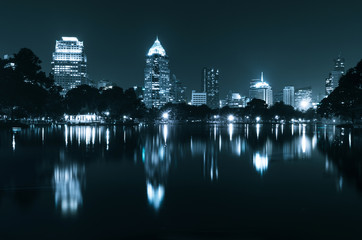 light from modern building bright in night city with skyline. glory night cityscape concept.