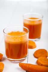 Carrot juice on a wooden table