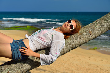 Carefree woman relaxing on tropical beach