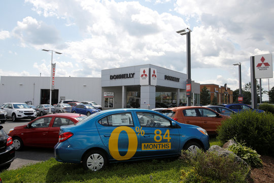 A car advertises an 84-month loan term at a Mitsubishi dealership in Ottawa