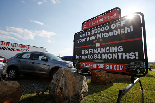 A sign advertises an 84-month loan term at a Mitsubishi dealership in Ottawa