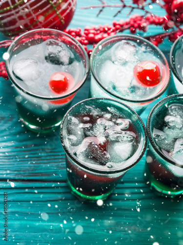 christmas party green alcohol drinks with cherry festive aperitif shots and ornaments on. Black Bedroom Furniture Sets. Home Design Ideas