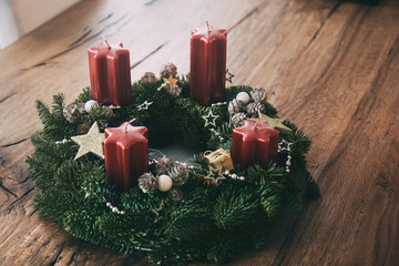 Advent wreath with four candles set four weeks before Christmas as traditionally in Switzerland