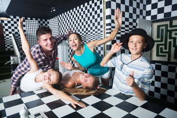 Parents with their children are satisfied after visit of escape room