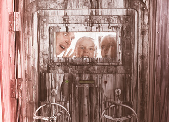 Portrait of a mad family behind a closed door