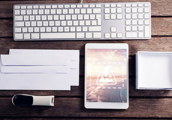 Tablet on Wooden Table with Desk Accessories Mockup