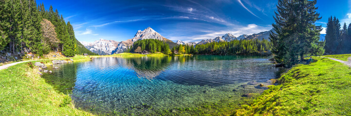 Foto auf Acrylglas Alpen Arnisee with Swiss Alps. Arnisee is a reservoir in the Canton of Uri, Switzerland.
