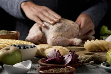 young man preparing a turkey